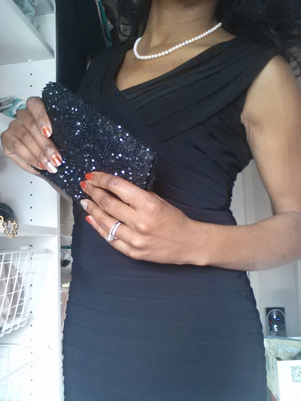 Adrianna Papell Ribbon Black Cocktail dress Cost: ~$65 (The beaded clutch is from Ann Taylor)
